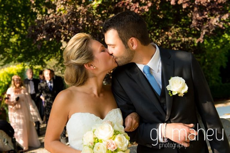 bride and groom kissing at Abbaye de Talloires, Lake Annecy wedding by Gill Maheu Photography, photographe de mariage