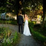 bride and groom walking in the gardens of Abbaye de Talloires, Annecy wedding by Gill Maheu Photography, photographe de mariage