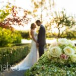 romantic full length portrait of bride and groom head to head in evening sunlight at Abbaye de Talloires, Annecy wedding by Gill Maheu Photography, photographe de mariage