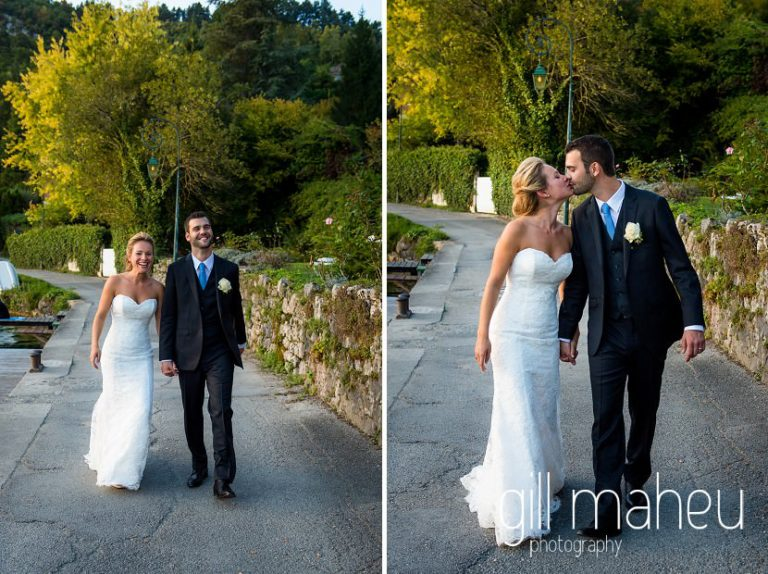 bride and groom walking along the lake shore on ponton jetty at Abbaye de Talloires, Lake Annecy wedding by Gill Maheu Photography, photographe de mariage