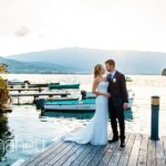 bride and groom kissing silhouetted against lake at Abbaye de Talloires, Annecy wedding by Gill Maheu Photography, photographe de mariage