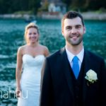 portrait of groom smiling with bride in background at Abbaye de Talloires, Lake Annecy wedding by Gill Maheu Photography, photographe de mariage