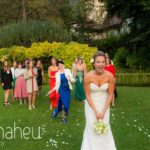 bride throwing her wedding bouquet at Abbaye de Talloires, Lake Annecy wedding by Gill Maheu Photography, photographe de mariage
