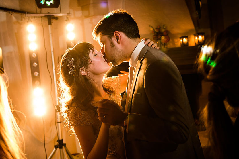 wedding couple first dance kiss