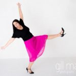 dancing in bright coloured natural relaxed headshot and branding photography session in white studio for young woman entrepreneur by Gill Maheu Photography, photographe de headshot et portrait