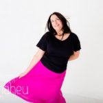 dancing and laughing at bright coloured natural relaxed headshot and branding photography session in white studio for young woman entrepreneur by Gill Maheu Photography, photographe de headshot et portrait