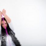 throwing pink sparle glitter at bright coloured natural relaxed headshot and branding photography session in white studio for young woman entrepreneur by Gill Maheu Photography, photographe de headshot et portrait