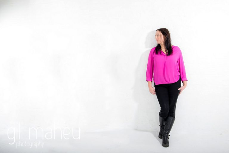 full length portrait at bright coloured natural relaxed headshot and branding photography session in white studio for young woman entrepreneur by Gill Maheu Photography, photographe de headshot et portrait