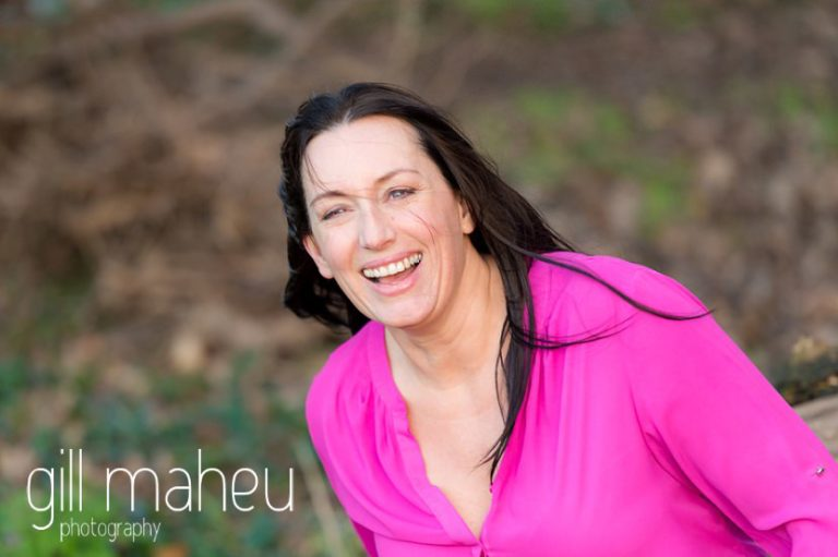 portrait of young woman entrepreneur in fabulous cerise pink shirt at natural light relaxed outdoor headshot and branding photography session by Gill Maheu Photography, photographe de headshot et portrait
