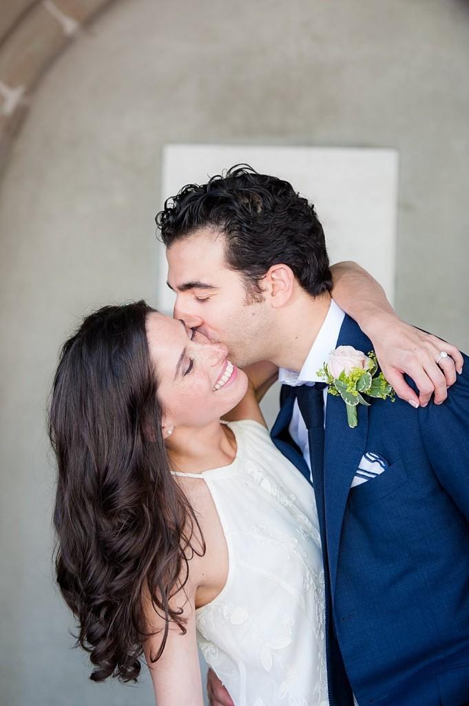 bride and groom hugging for joy