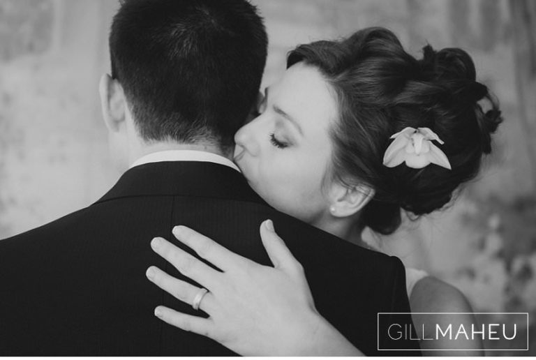 romantic black and white portrait of bride kissing groom at Lausanne wedding by Gill Maheu Photography, photographe de mariage
