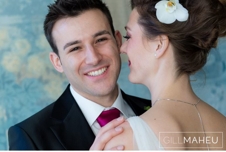 portrait of groom smiling over bride's shoulder at Lausanne wedding by Gill Maheu Photography, photographe de mariage