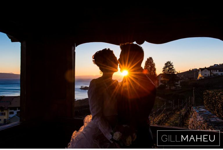 close up portrait of bride and groom embracing in front of sunset over Lac Léman at Lausanne wedding by Gill Maheu Photography, photographe de mariage