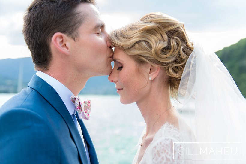 romantic kiss - stunning bride and groom by Lake Annecy