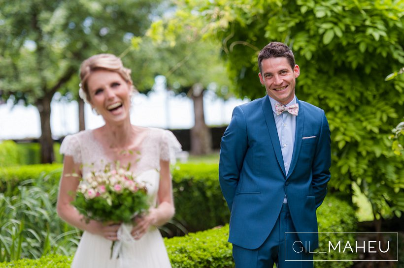 bride and groom laughing in the gardens of the abbaye de talloires