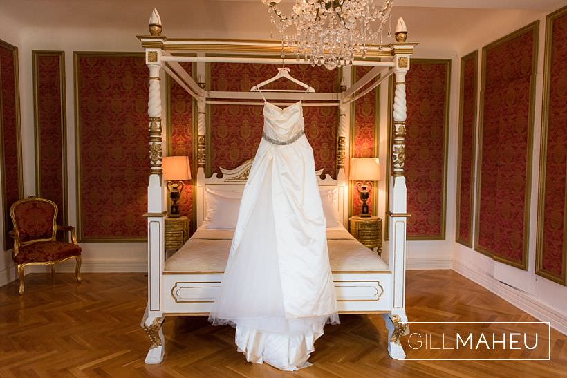 the fabulous wedding dress hanging from for poster bed at a chateau in provence