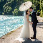 sigh bride groom parasol sunlit lake - very romantic