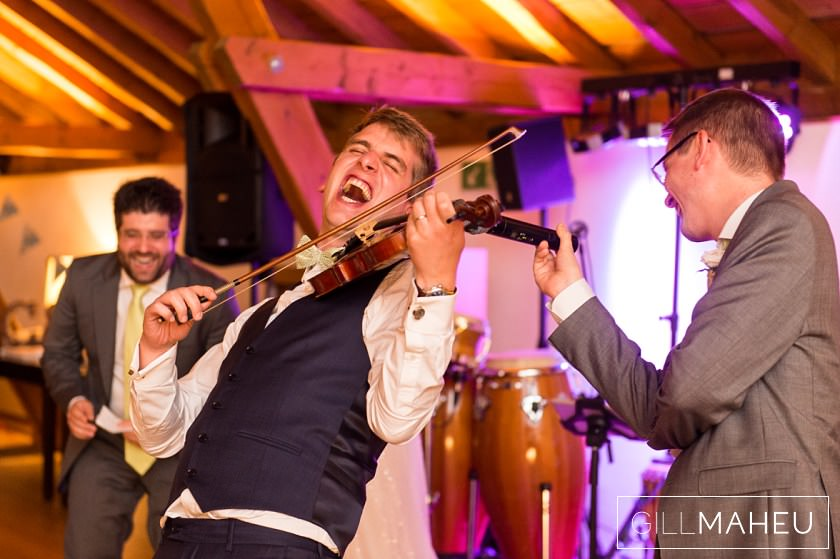 go for it groom - laughing groom playing the violin