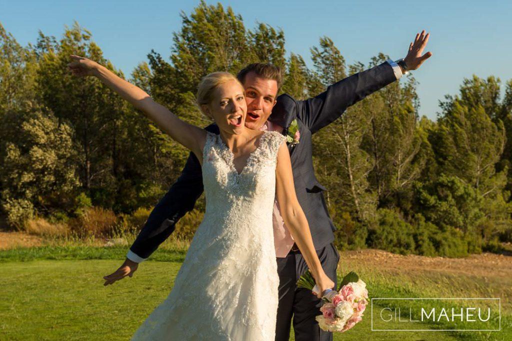 fun shot of a very happy bride and groom