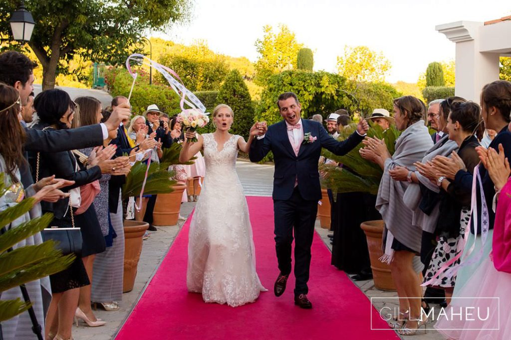 bride and groom celebrating on the red carpet