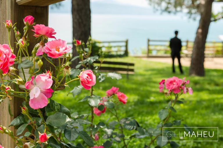 groom waiting for his bride at first look in park overlooking Lutry, Lausanne wedding by Gill Maheu Photography, photographe de mariage