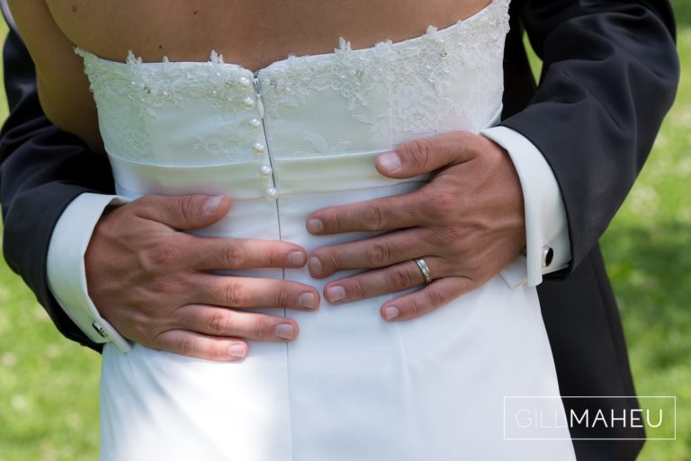 groom's hand on bride's waist at first look in park overlooking Lutry, Lausanne wedding by Gill Maheu Photography, photographe de mariage