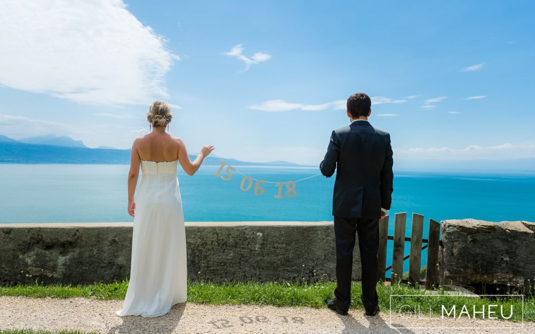 bride and groom looking out over lake geneva at blue sky summer wedding Lutry, Lausanne wedding by Gill Maheu Photography, photographe de mariage