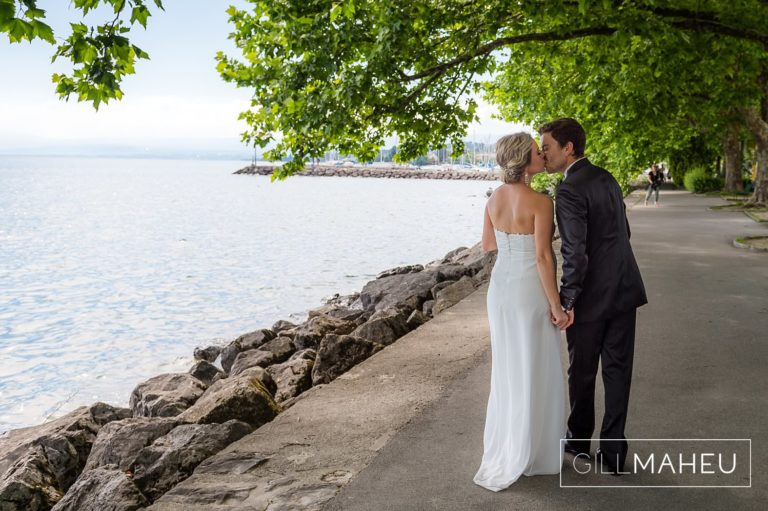 bride and groom walking along the shores of lac leman at Lutry, Lausanne wedding by Gill Maheu Photography, photographe de mariage