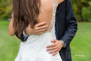 close up of groom's arms around bride's waist and details of her Rime Arodaky wedding dress at Chene Bougeries, Geneva wedding by Gill Maheu Photography, photographe de mariage