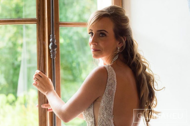 portrait of thte bride at the window of the sute nuptiale at the Abbaye de Talloires, Annecy wedding by Gill Maheu Photography, photographe de mariage