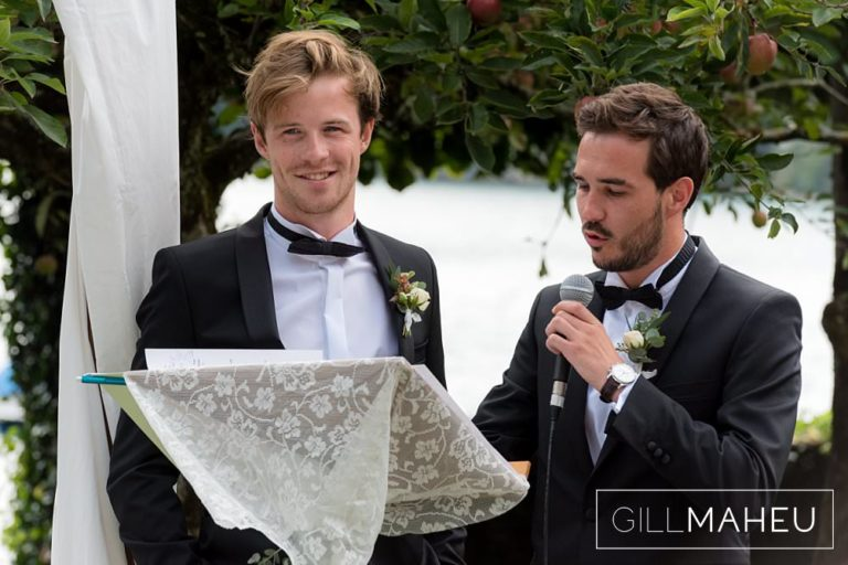 brothers of the groom reading a speech during outdoors ceremony in the gardens of the Abbaye de Talloires, Annecy wedding by Gill Maheu Photography, photographe de mariage