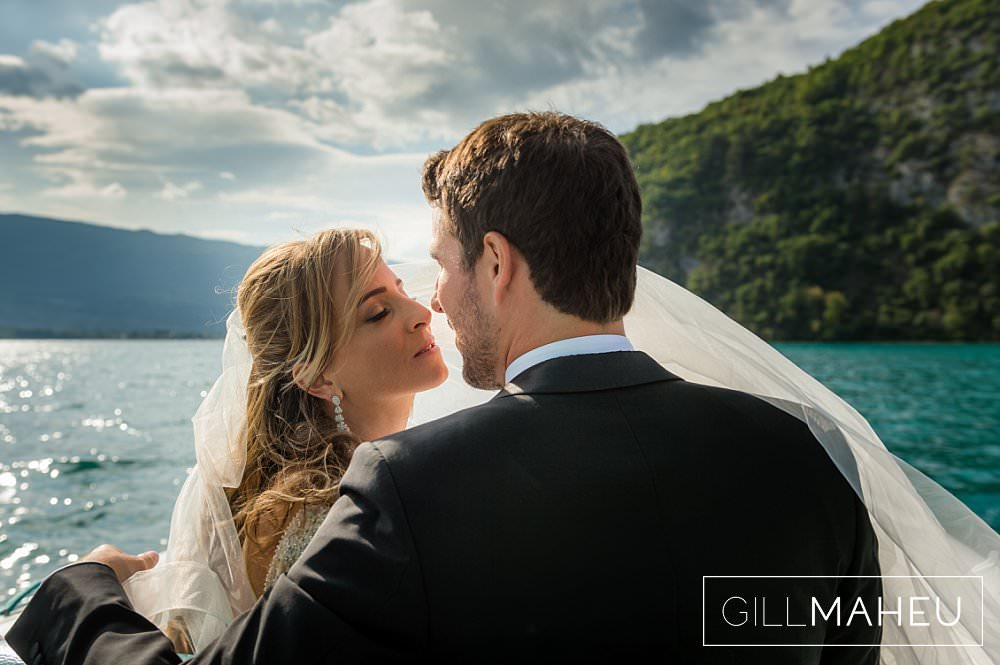 bride and groom head to head in the sunshine by the lake at Abbaye de Talloires, Annecy wedding by Gill Maheu Photography, photographe de mariage