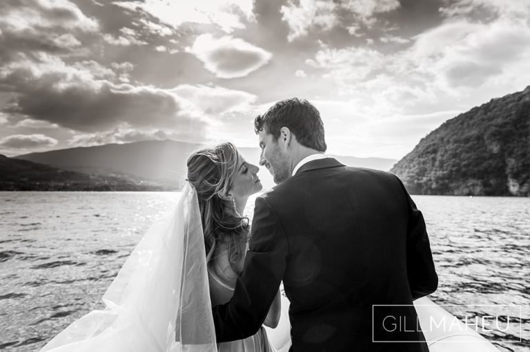 very romantic black and white portrait of bride and groom kissing against the setting sun in Abbaye de Talloires, Annecy wedding by Gill Maheu Photography, photographe de mariage