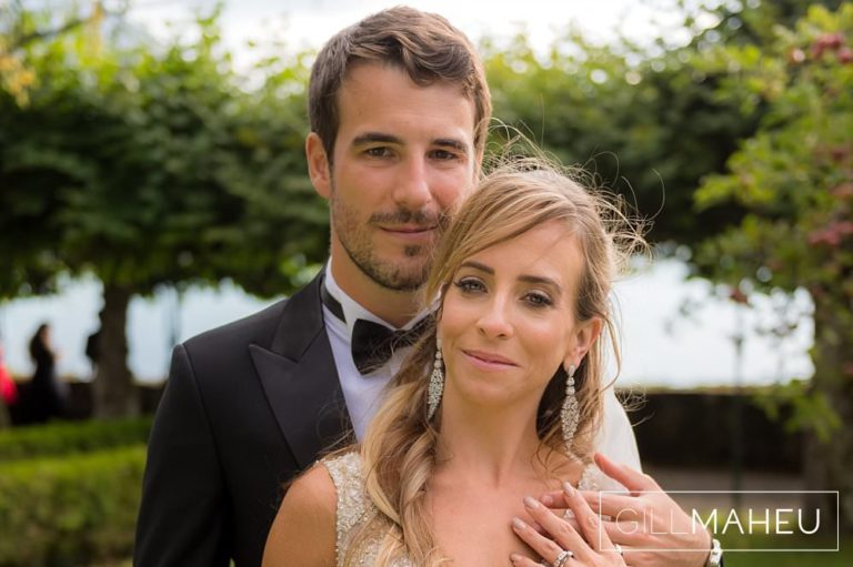 groom tenderly holding bride in portrait in the gardens of the Abbaye de Talloires, Annecy wedding by Gill Maheu Photography, photographe de mariage