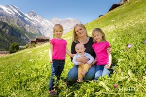 mum, two daughters and baby at summer sun lifestyle photography session with beautiful young family in Gimmelwald, Switzerland by Lifestyle photographer Gill Maheu Photography, photographe de famille