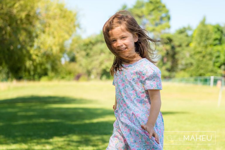 portrtait of young girl in dappled sunlight at summer sun lifestyle photography session with beautiful young family in Lausanne by Lifestyle photographer Gill Maheu Photography, photographe de famille