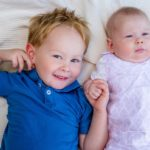 close up portrait of young boy and his babysister at Lac Leman, Lausanne, Switzerland by Lifestyle photographer Gill Maheu Photography, photographe de famille