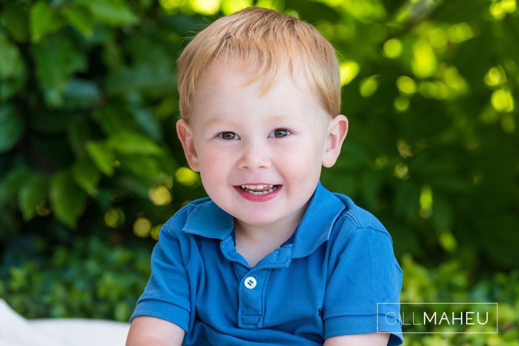 close up portrait of adorable cheeky young boy at Lac Leman, Lausanne, Switzerland by Lifestyle photographer Gill Maheu Photography, photographe de famille