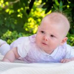 portrait of adorable baby girl at Lac Leman, Lausanne, Switzerland by Lifestyle photographer Gill Maheu Photography, photographe de famille