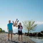 happy young family playing on the beach at Lac Leman, Lausanne, Switzerland by Lifestyle photographer Gill Maheu Photography, photographe de famille