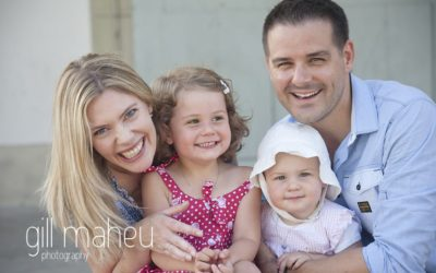 close up lifestyle portrait of parents with two toddlers in a park in Geneva Geneve by Gill Maheu Photography, photographe de famille