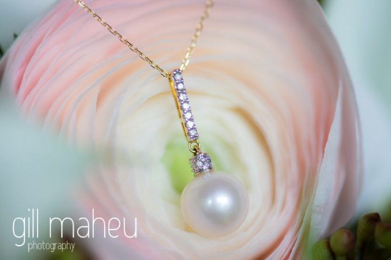 close up details of stunning pearl necklace on anenome wedding bouquet at Hotel La Reserve, Geneve wedding by Gill Maheu Photography, photographe de mariage