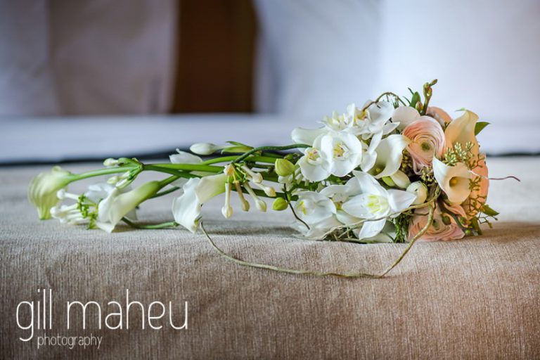 close up details of stunning white arum lily and anenome wedding bouquet at Hotel La Reserve, Geneve wedding by Gill Maheu Photography, photographe de mariage