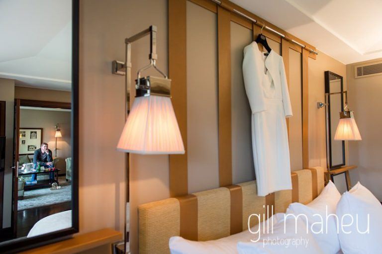 his and hers wedding outfits hanging next to each other on the wall at Hotel La Reserve, Geneve wedding by Gill Maheu Photography, photographe de mariage
