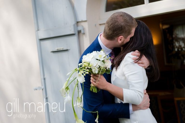 newly wed couple kissing outside their civil wedding at Mairie de Versoix by Gill Maheu Photography, photographe de mariage
