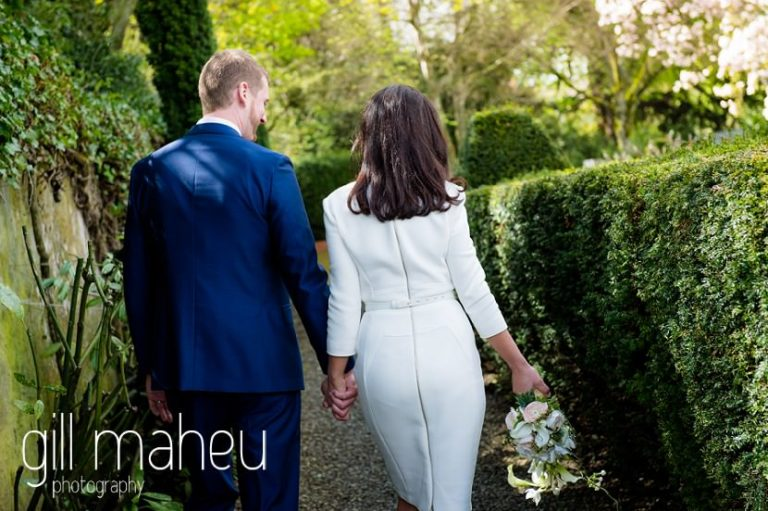 newly wed couple walking away together after their civil wedding at Mairie de Versoix by Gill Maheu Photography, photographe de mariage