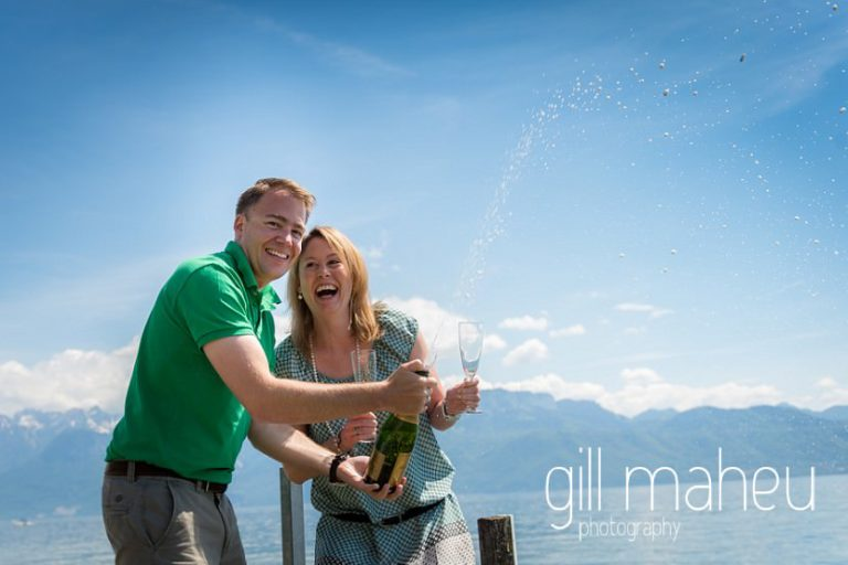engaged couple popping champagne bottle to celebrate on speed boat on Lac Léman, Lausanne engagement session by Gill Maheu Photography, photographe de mariage