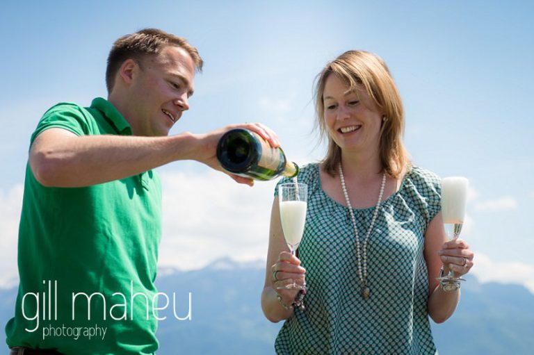 engaged couple pouring champagne to celebrate on speed boat on Lac Léman, Lausanne engagement session by Gill Maheu Photography, photographe de mariage