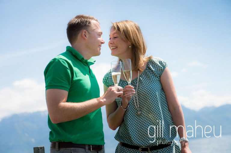 engaged couple toasting each other with champagne on  speed boat on Lac Léman, Lausanne engagement session by Gill Maheu Photography, photographe de mariage