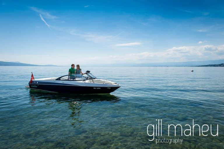 engaged couple on speed boat on Lac Léman, Lausanne engagement session by Gill Maheu Photography, photographe de mariage